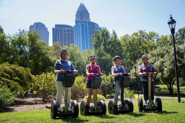 026 Charlotte NC Tours Segway Tour stops in Fourth Ward Park for a photo opp with the Charlotte skyline_Photo courtesy of charlottesgotalot.com